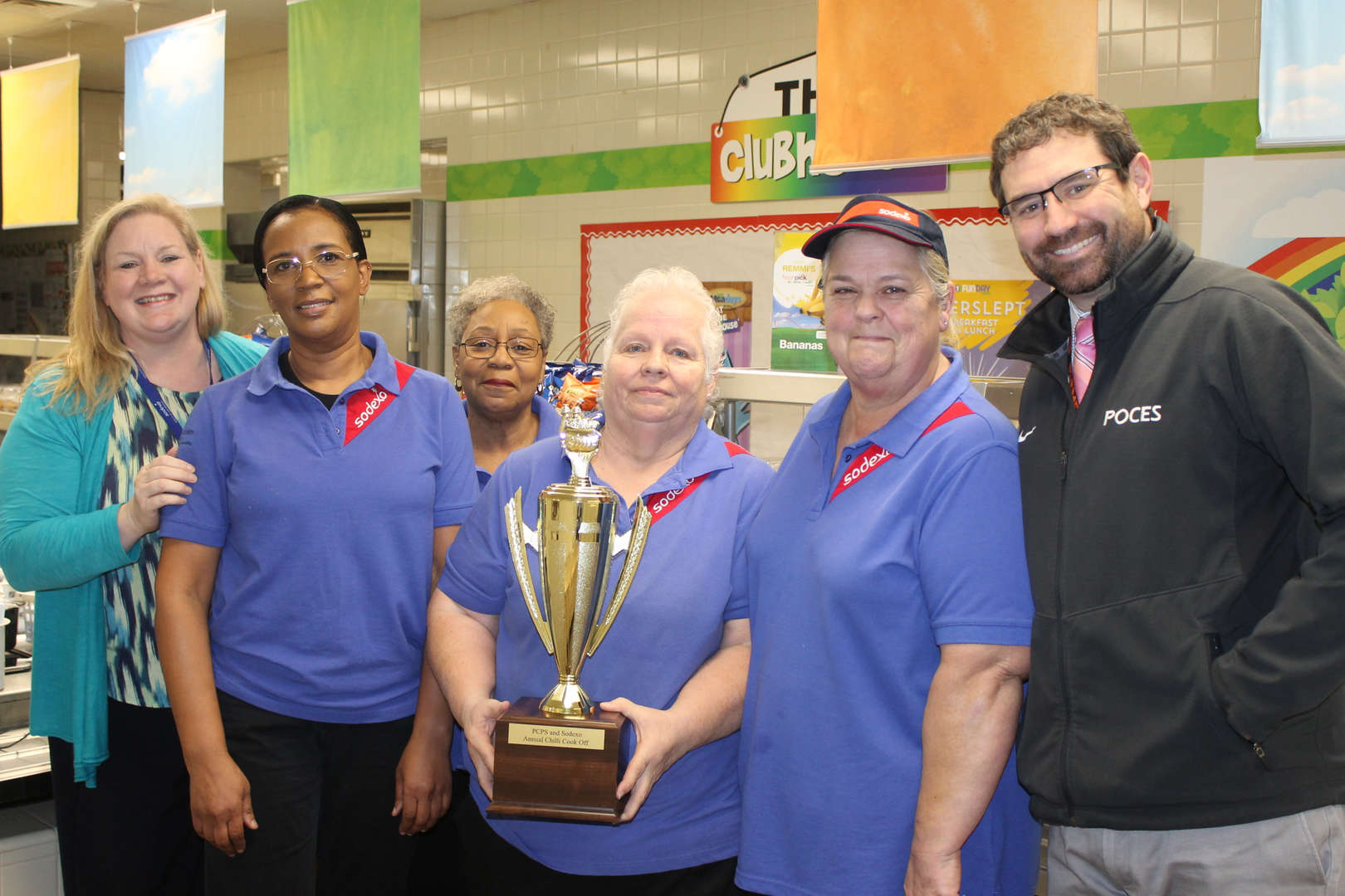 Thomas Sulzer, cafeteria staff, Dorothy Kohler with chili cookoff trophy