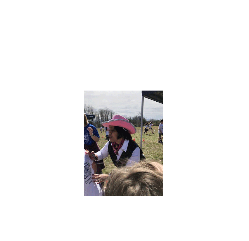 Mrs. Nelson in pink cowgirl hat