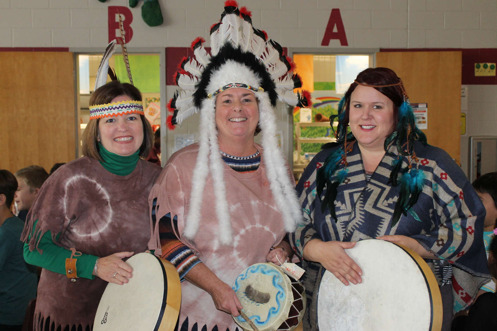 Three teachers dressed up for Native American Day in Kindergarten