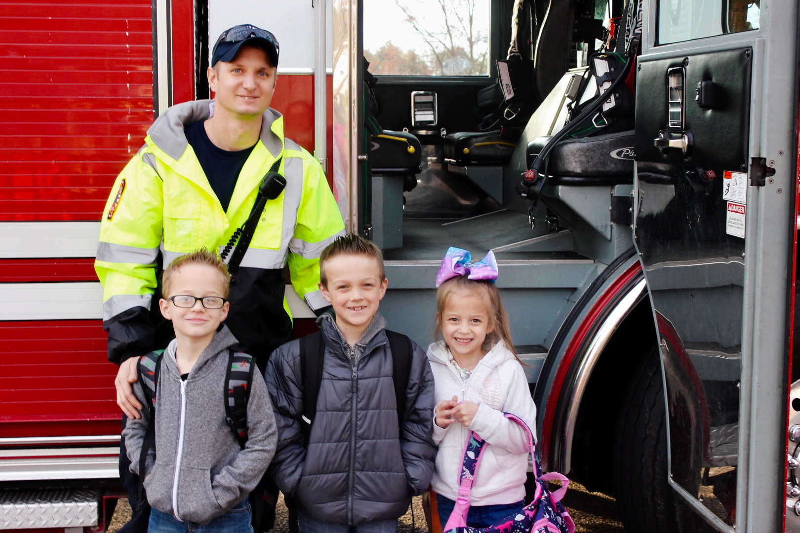 Students win a Fire truck ride to school