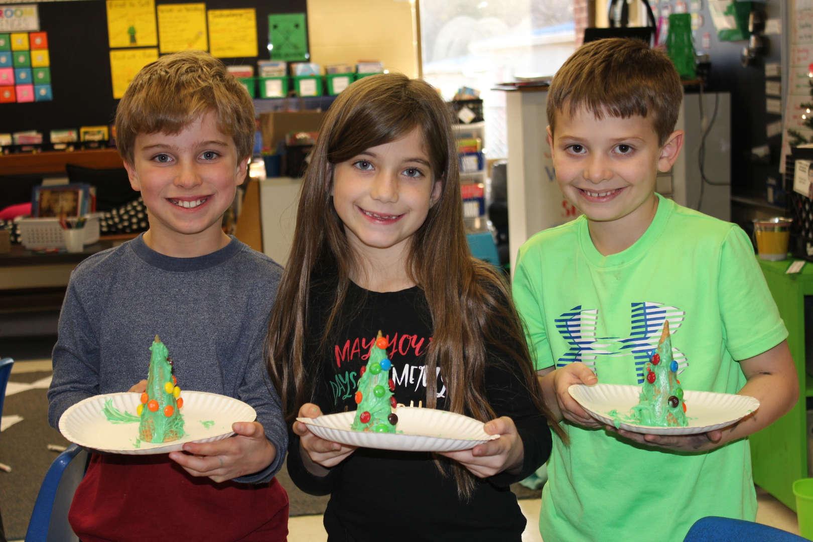 Students enjoying holiday treats.