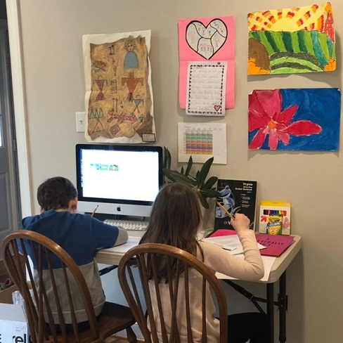 two children working at home on the computer