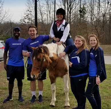 Mrs. Nelson, Principal, on horseback with Boosterthon Team