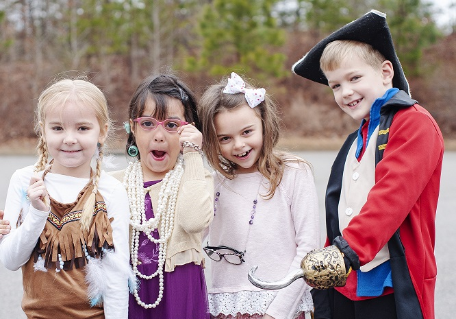 four students dressed up as famous historians
