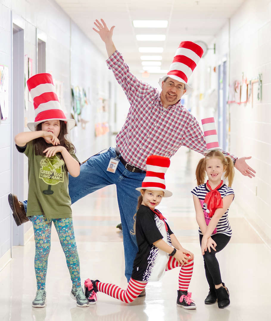 Mr. Thompson and students wearing Cat in the Hat top hats