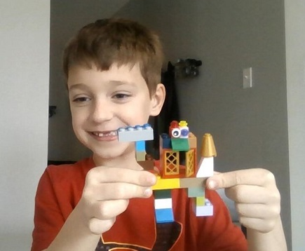 student with lego figure he created