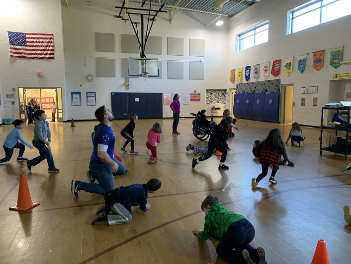 Alec from Boosterthon participated with children in PE class
