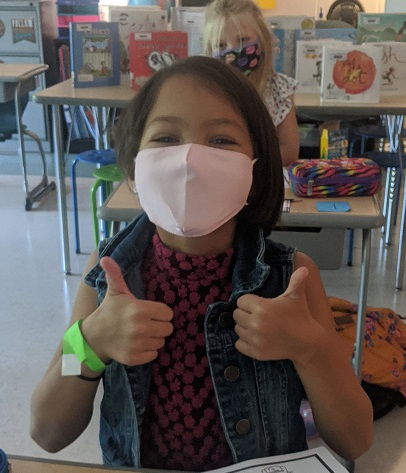 third grader gives thumbs up in Mrs. Osborne's class