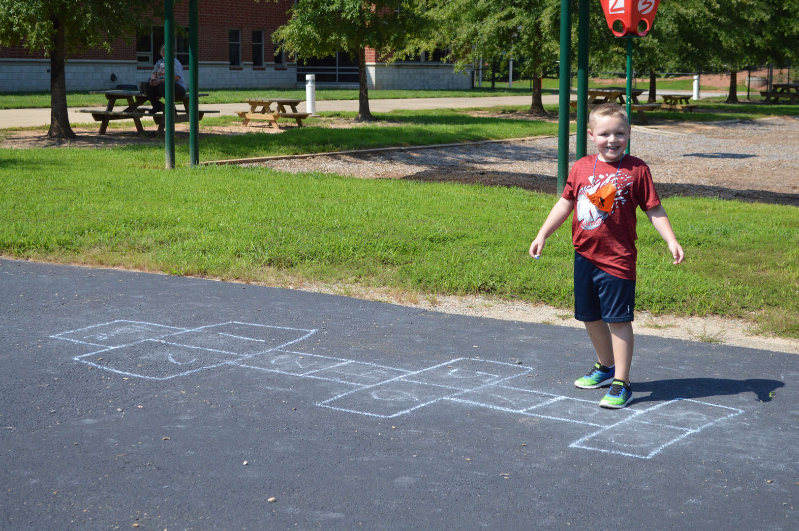 student playing hopscotch at recess