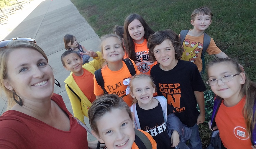 Mrs. Ayers took a selfie with her students on the playground