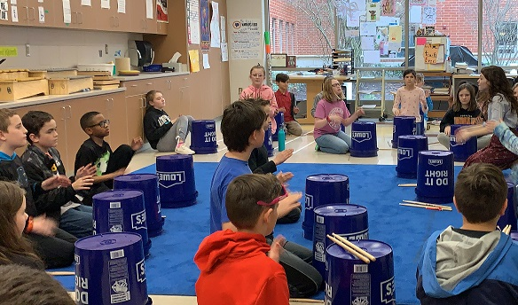 fifth grade students played on the bucket drums