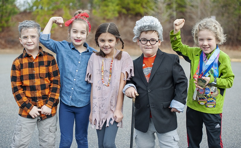 four students posing as historical figures