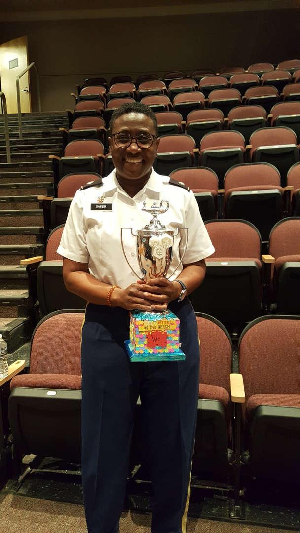 Baker holding trophy