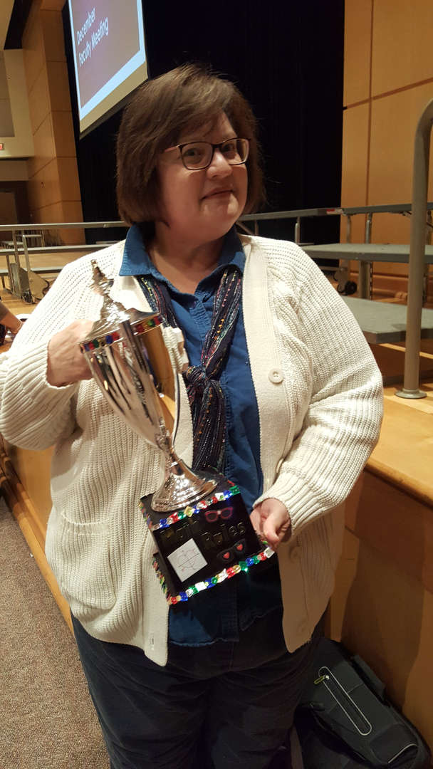 Simonick holding trophy