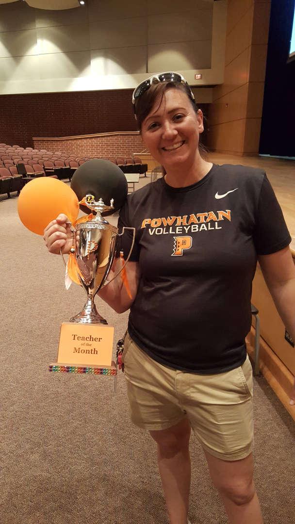 Foos holding trophy