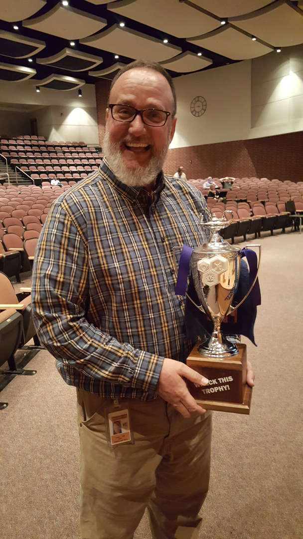 Bird holding trophy