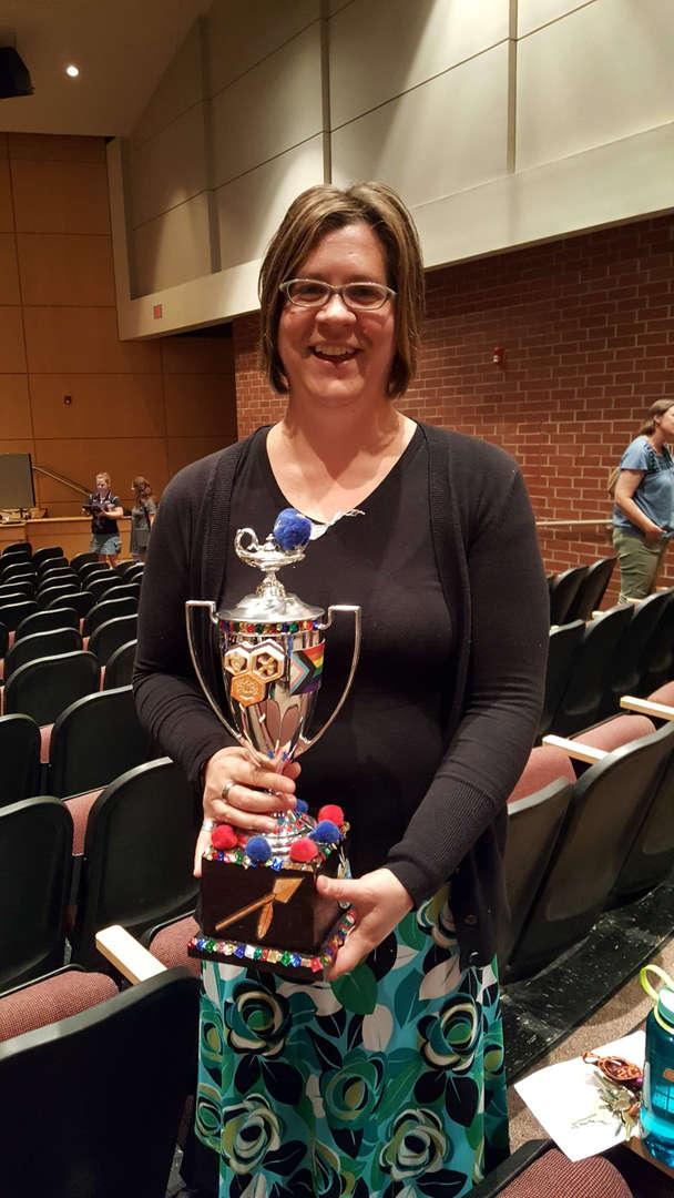 Lisker holding trophy