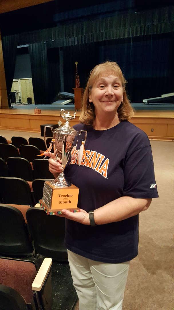 Novak holding trophy
