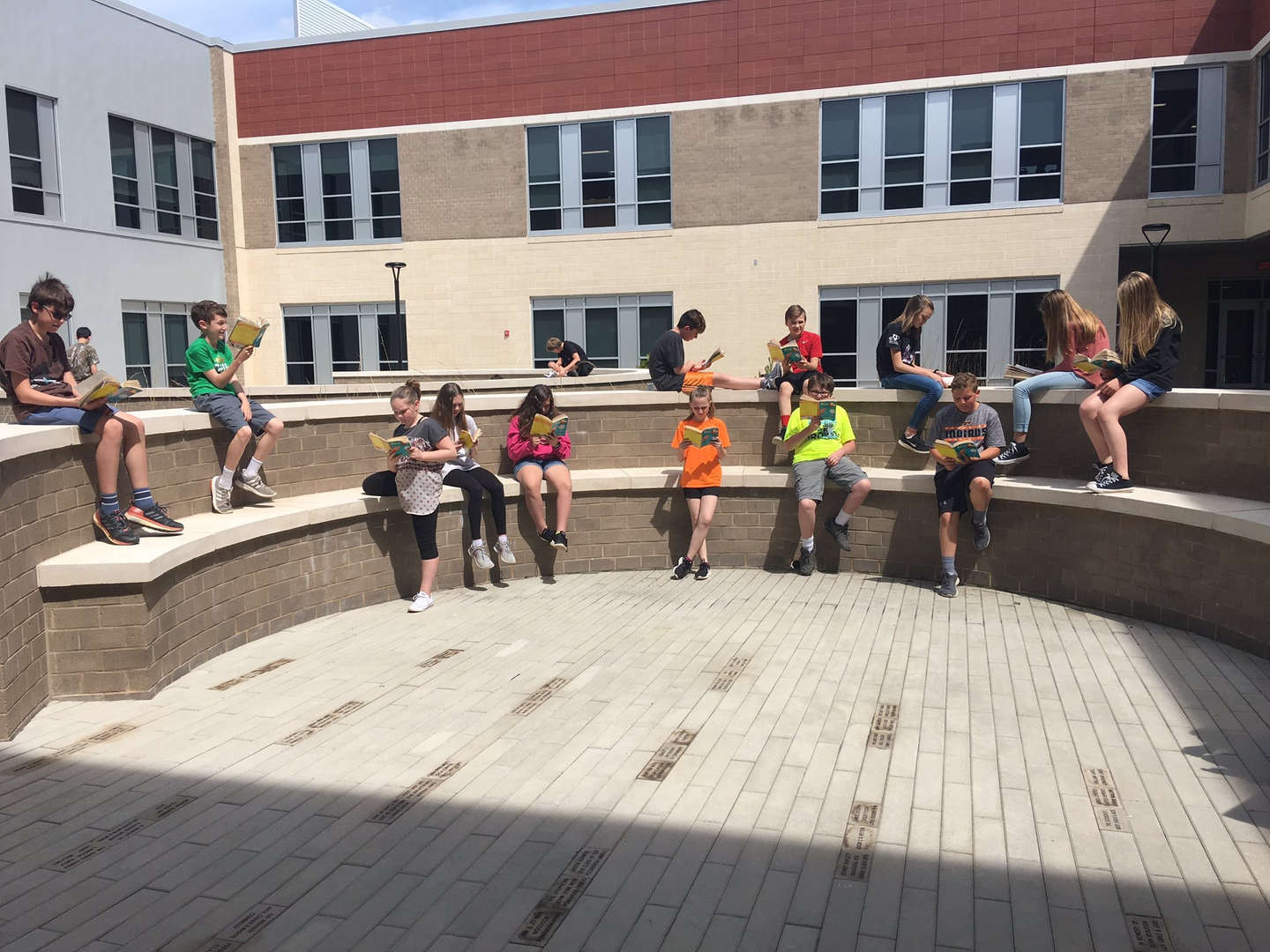 Students reading in courtyard