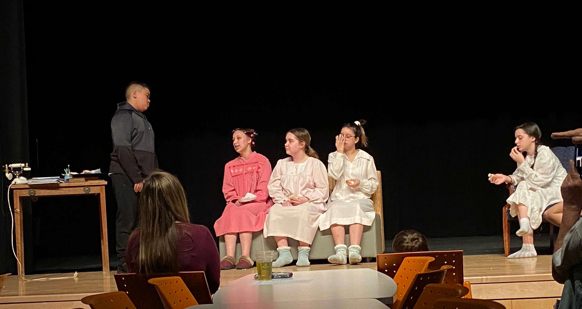 students on stage for play