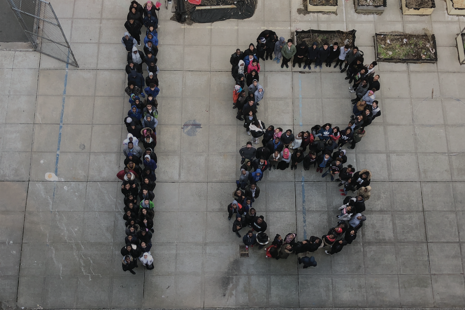Aerial shot of students in number 18 formation