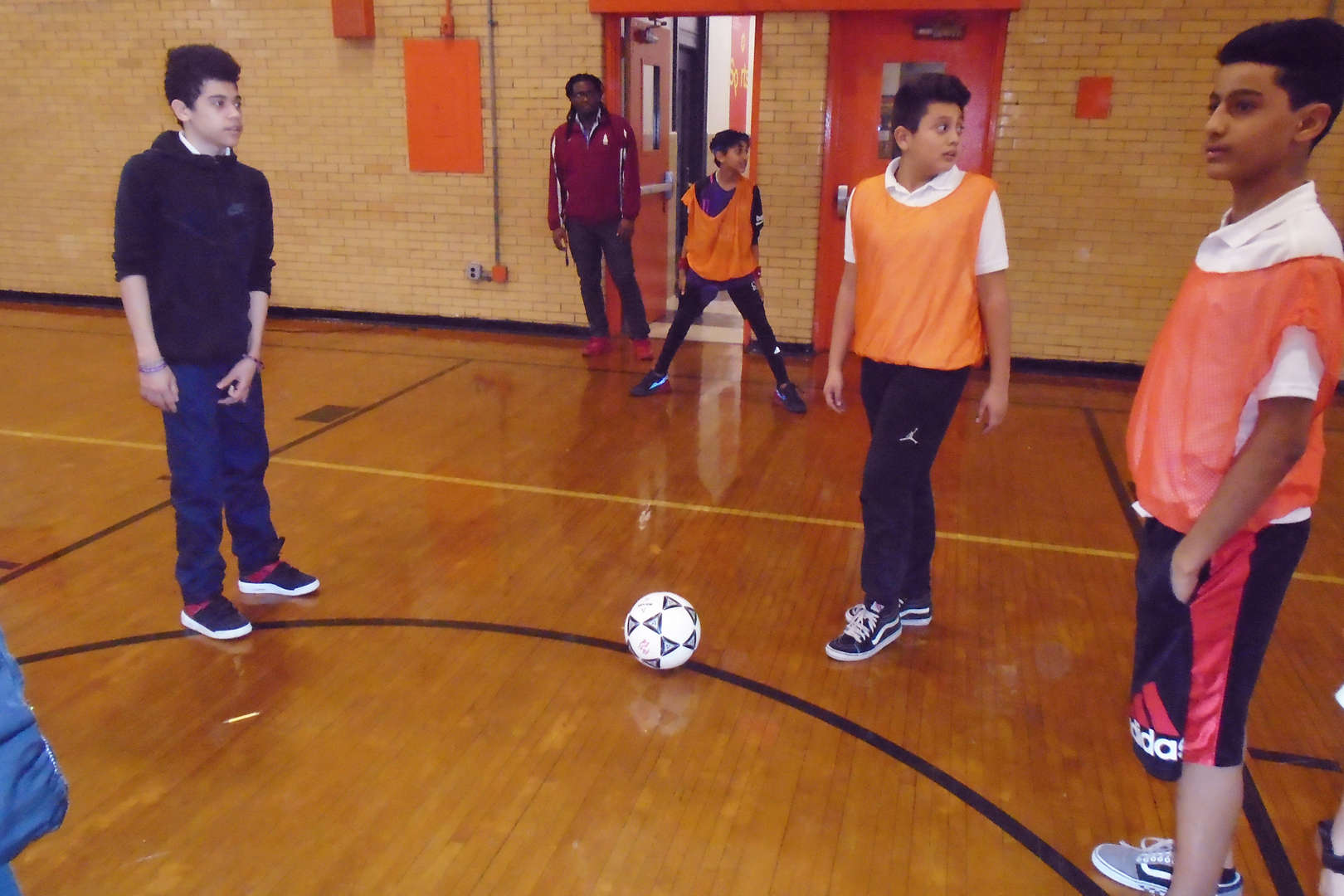 Students playing soccer together