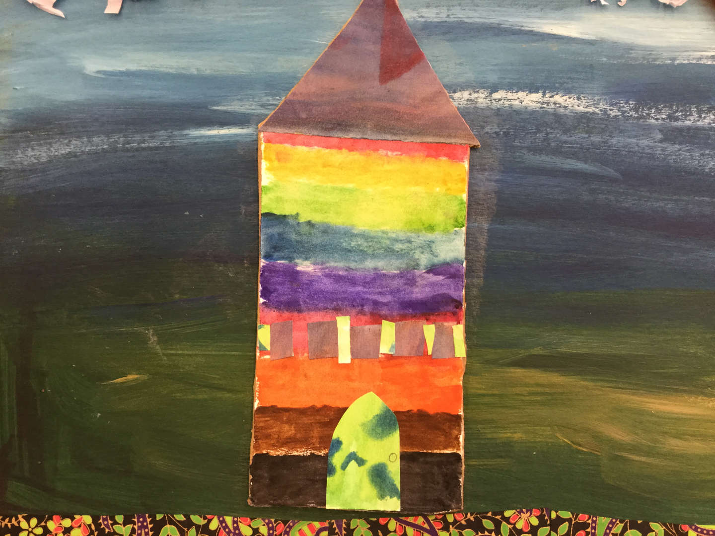 Student collage of a rainbow building