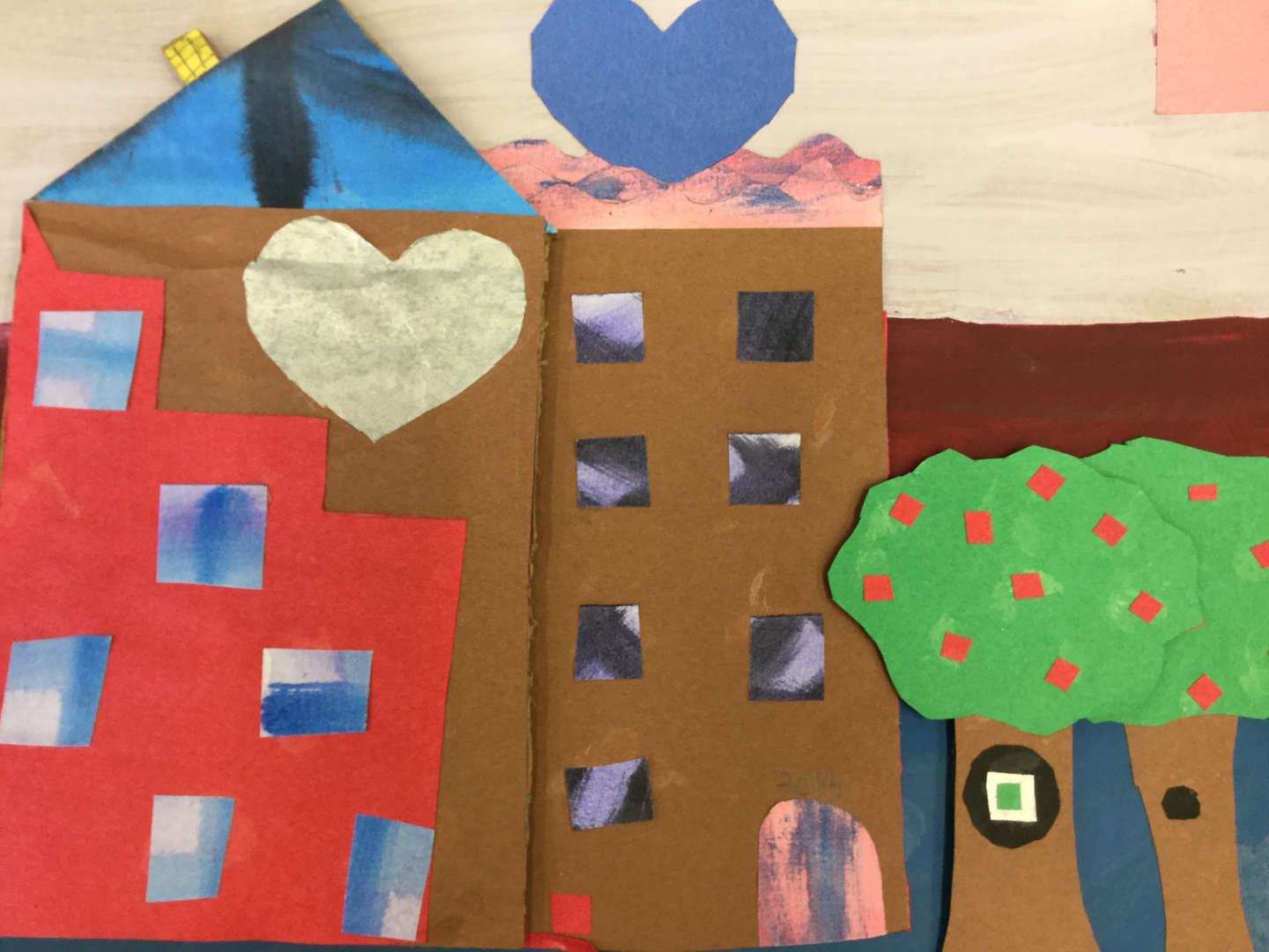 Student collage of buildings with heart