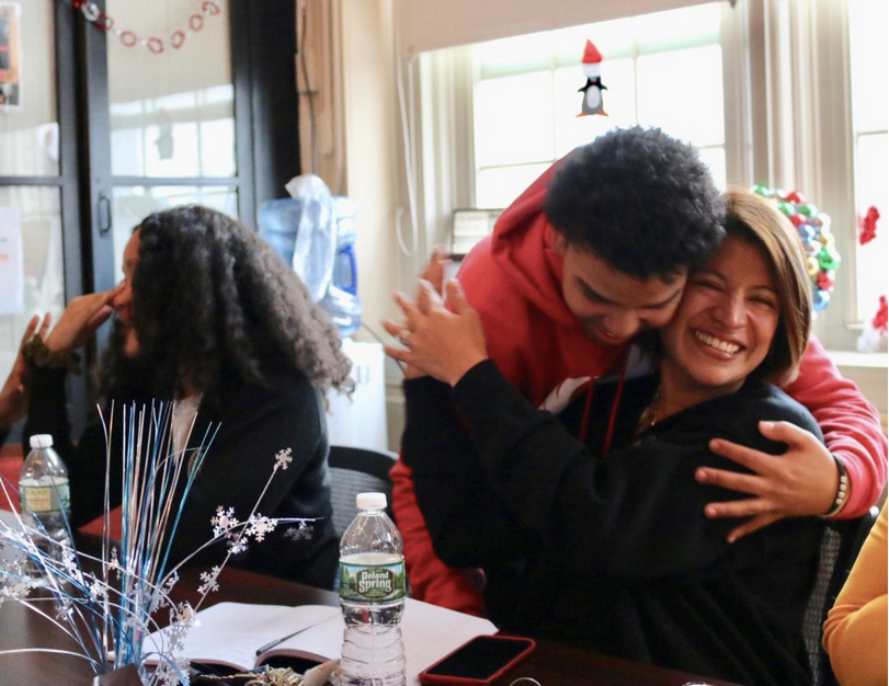 Fordham Leadership Academy Principal Fiorella Cabrejos celebrates with student Jasiel Nuñez after learning they are advancing to the next round of a competition to open or overhaul 40 schools.                                                                                                    PHOTO CREDIT: Alex Zimmerman/Chalkbeat