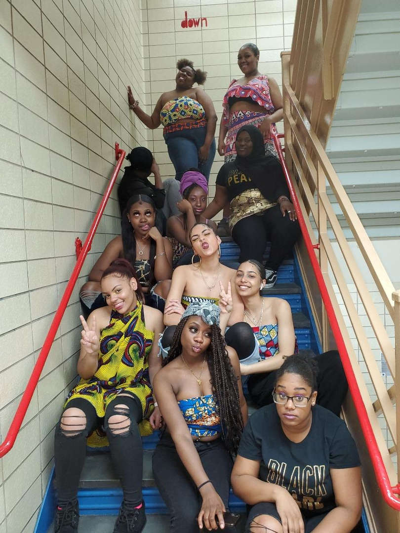 Students posing in staircase