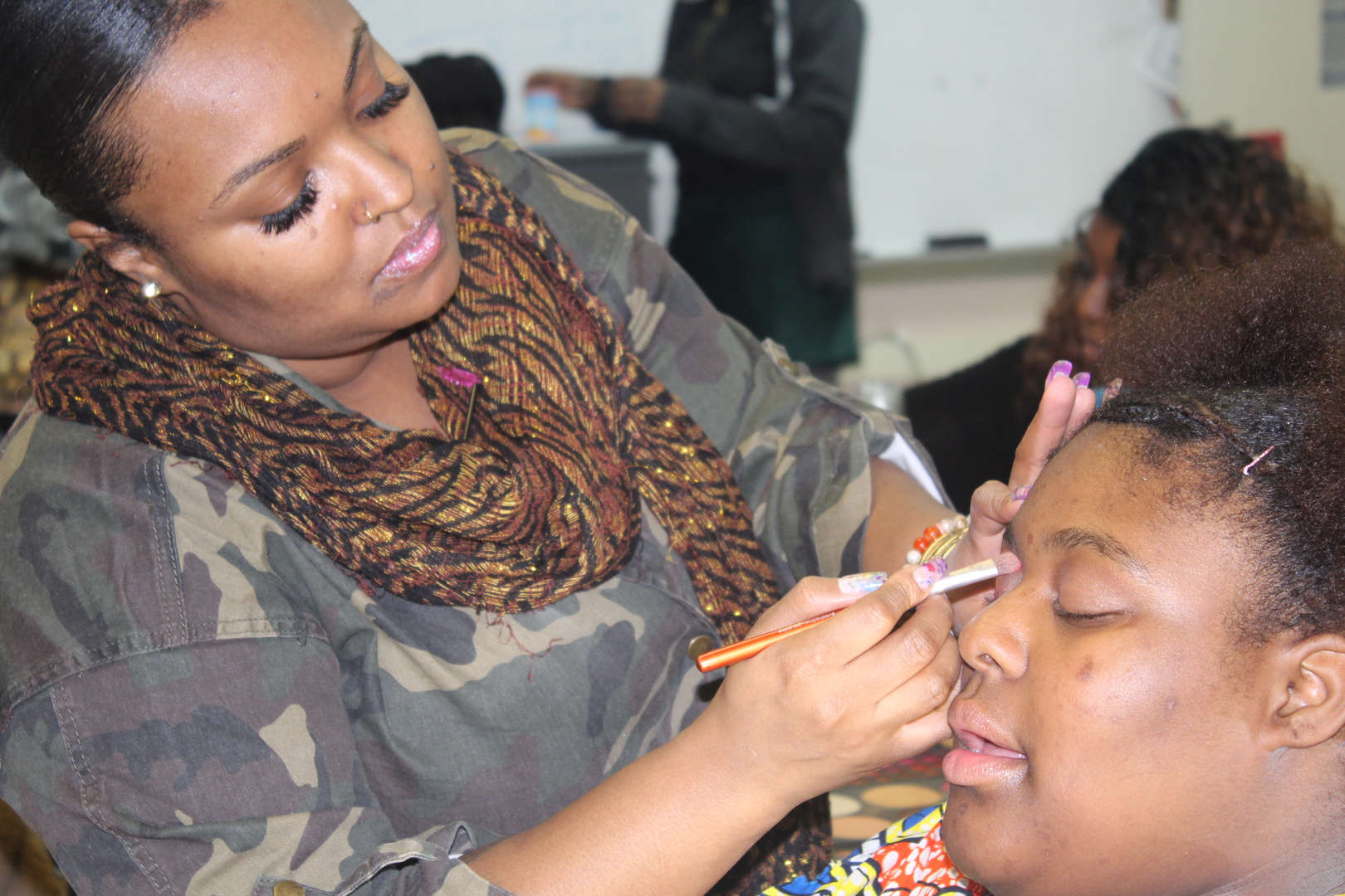 Student getting make-up done
