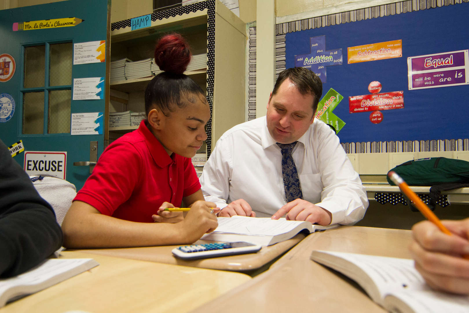 Principal H working with a student