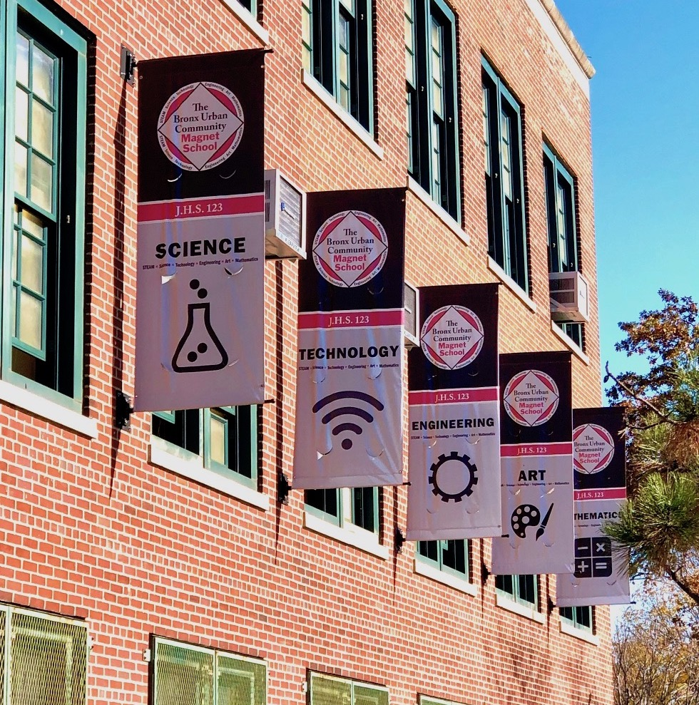 STEAM banners on the outside of the school building.