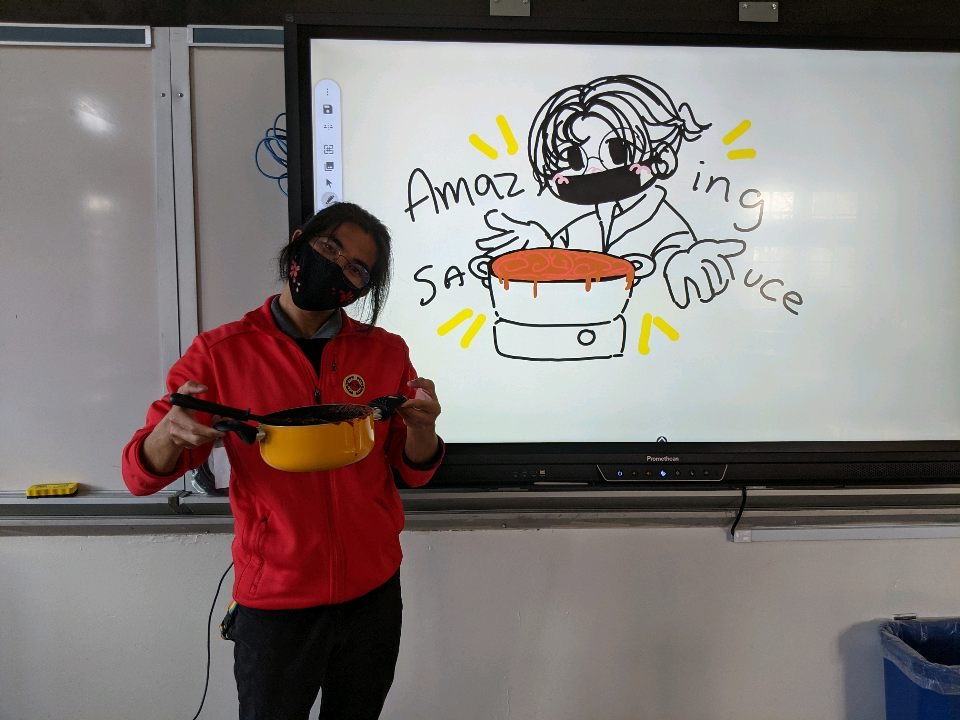 Mr. Dizon with a drawing of him