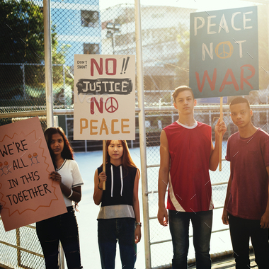 Student activists with protest signs.
