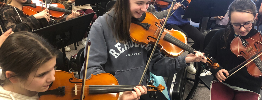 Musicians from high school and middle school come together in the Big/Little Orchestra.