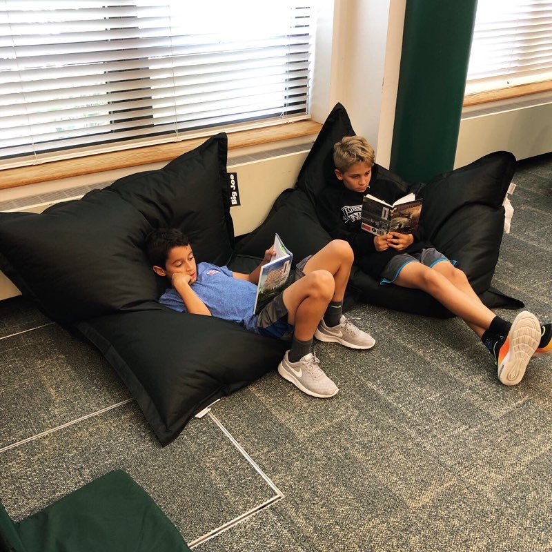 Students enjoying flexible seating while they read.