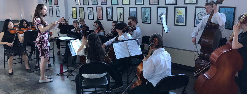 The Chamber Orchestra performing at the 5th grade parent orientation.