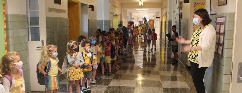 Principal Cristy Harris notices the students' yellow skirts and yellow shirts ... it must be Yellow Day in kindergarten!