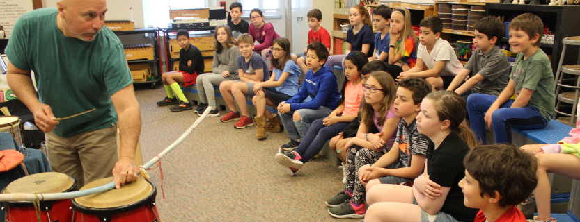Each class explored the world of drumming with John Arrucci--culminating in an all-school performance.