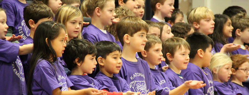 First graders sing for the whole school at the November Sharing Assembly.