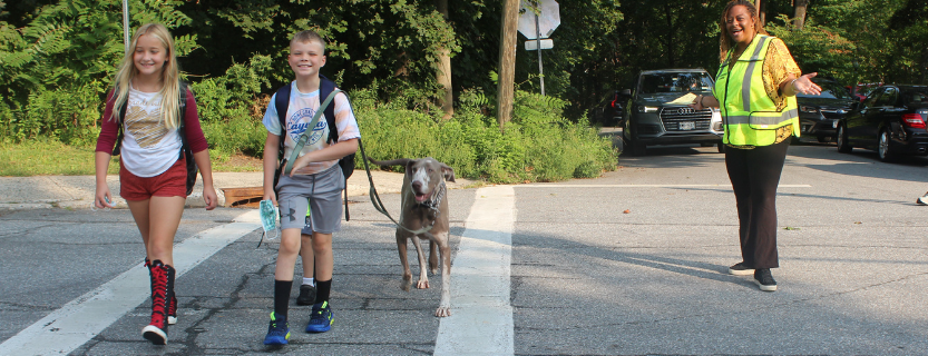 Crossing Guard Toyin keeps it safe for students, parents and pups!