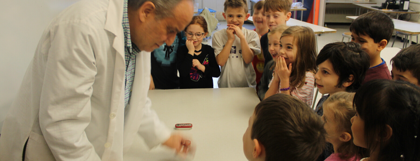 First graders learn about the nature of sound with Dr. Jeff, a visiting scientist.