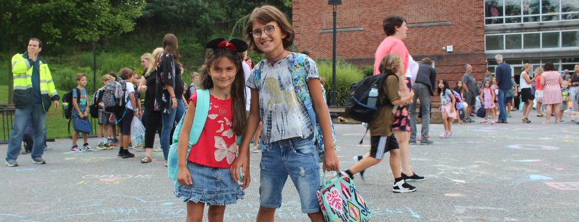 The first day of school was exciting! Students find their friends and teachers and walk inside together.