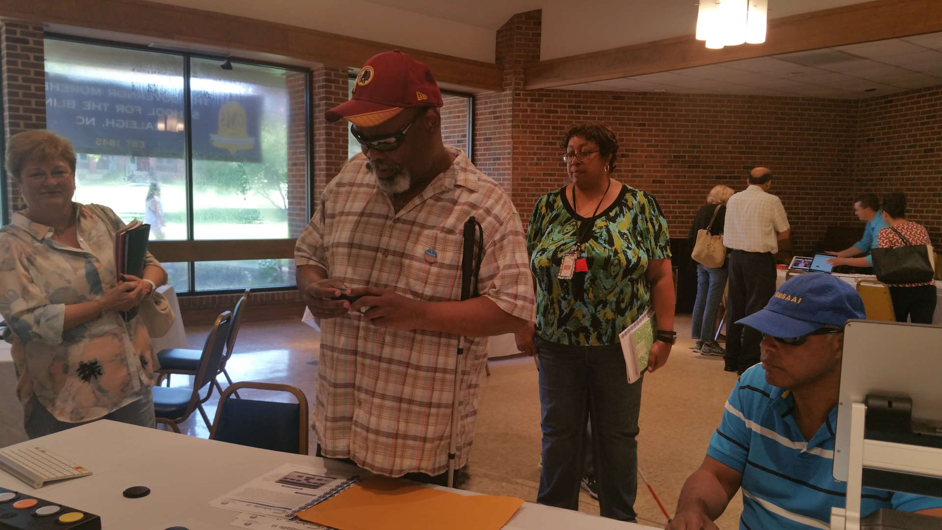 Participants try out resources located at different stations around the room.