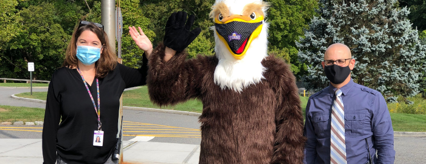 Principal Kerry Ford, Eddie the Eagle, and Assistant Principal Dr. Michael Weschler welcome students!