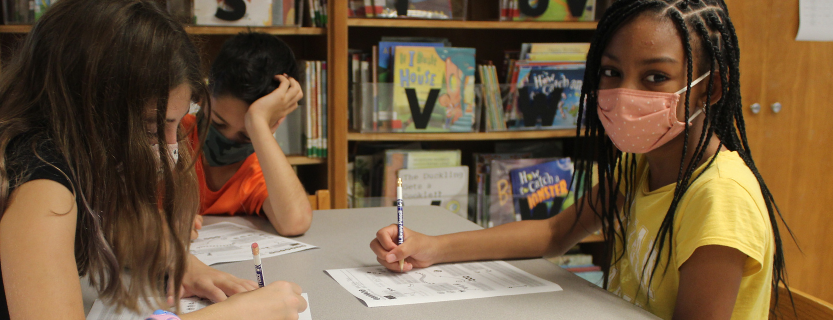 Students share their favorite books with Librarian Juli Hoffman.
