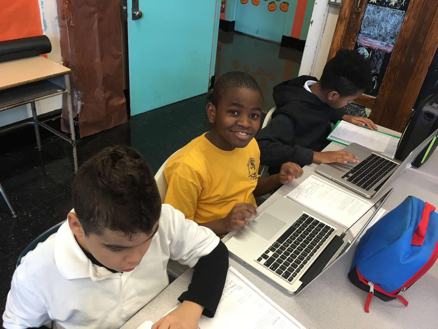 Students typing code into computers.