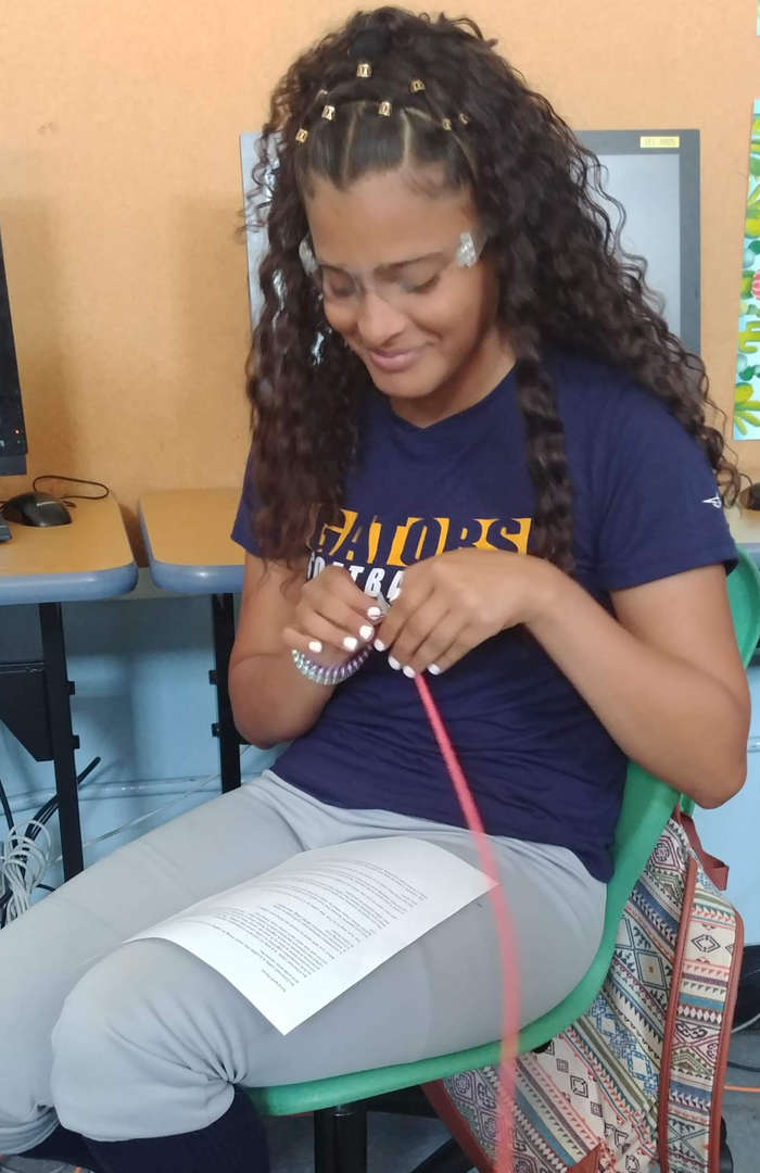 Student is arranging the network cables using her manual.