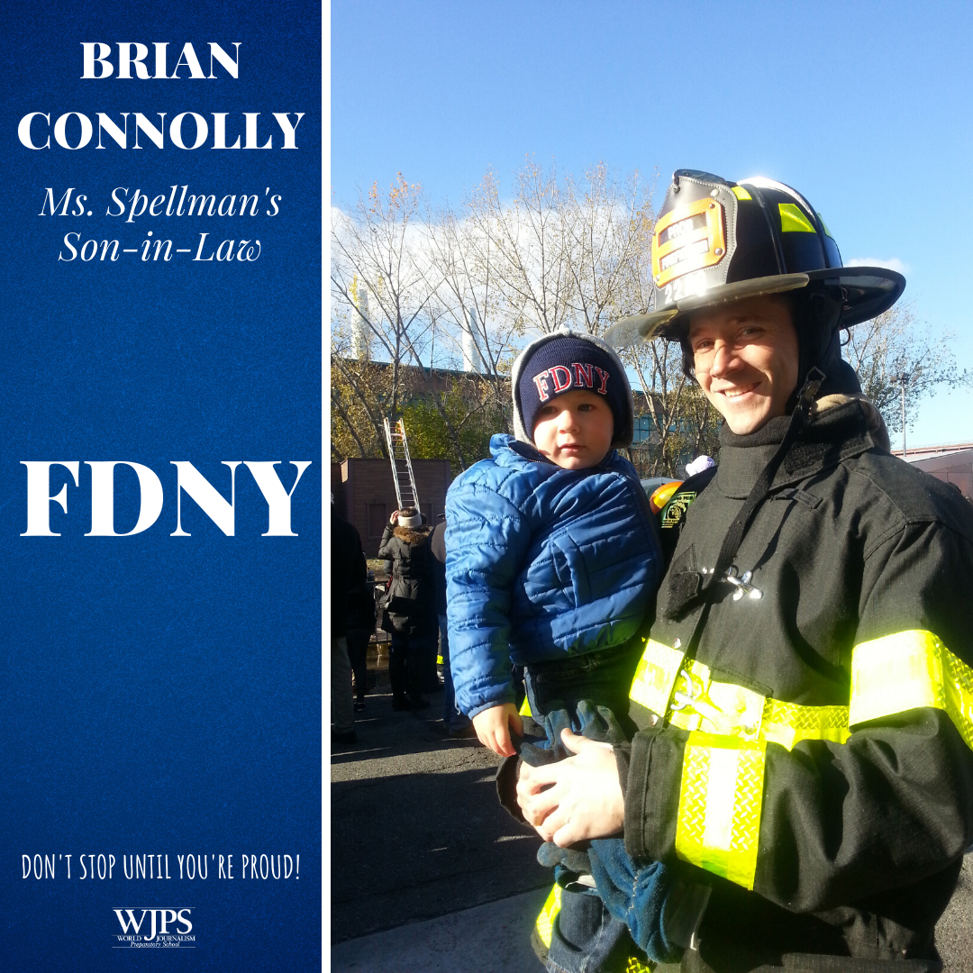male firefighter holding toddler